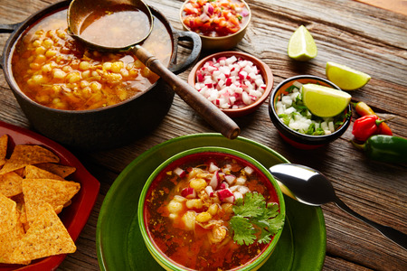 Pozole with mote big corn stew from Mexico with ingredients and appetizer