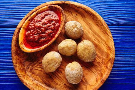 mojo: Papas arrugas al mojo wrinkled potatoes Canary islands recipe red spicy sauce Stock Photo