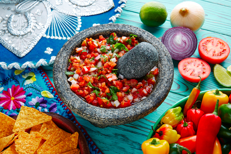 piquancy: Pico de Gallo sauce from Mexico with tomato cilantro and onion in molcajete Stock Photo