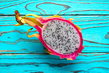 Pitaya dragon fruit cutted in pink and green background