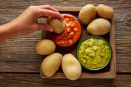 wrinkled: Papas arrugas al mojo Canary islands wrinkled potatoes with green and red sauces