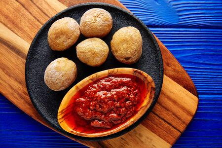 wrinkled: Papas arrugas al mojo wrinkled potatoes Canary islands recipe red spicy sauce Stock Photo