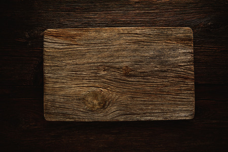 aged wood: Aged wood cutting board as a copyspace background for any theme message
