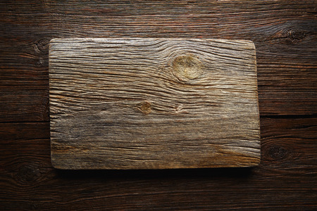 wood board: Aged wood cutting board as a copyspace background for any theme message