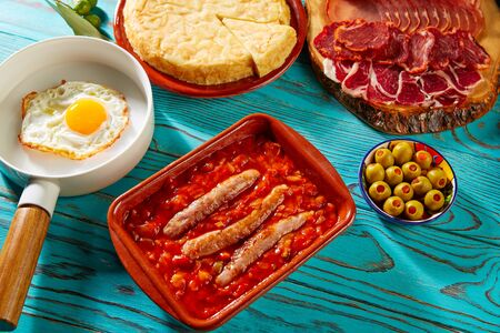 spicy food: Tapas pisto con tomate ratatouille egg and sausage from Spain