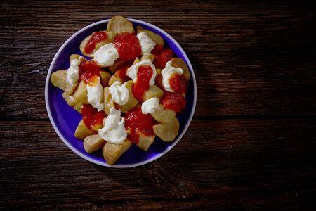 potatoe: Tapas Patatas Bravas potatoe fries with tomato and mayonaise from Spain