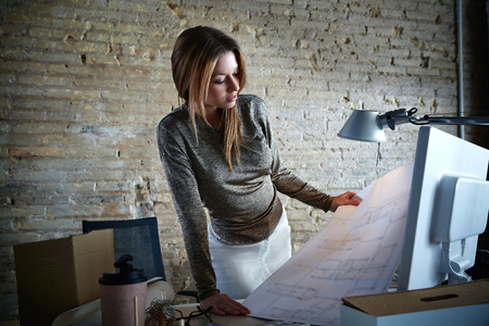 architect office: Architect engineer woman working with plan at office indoor Stock Photo
