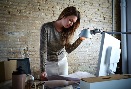 Office women: Architect engineer woman working with plan at office indoor Stock Photo