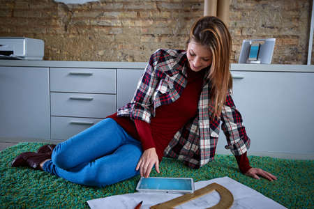 woman laying: Architect student woman doing homework at home carpet