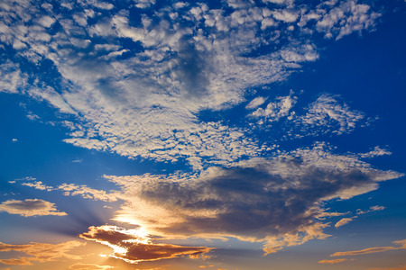 fluffy clouds: Sunset sky with golden and blue clouds in Mediterranean