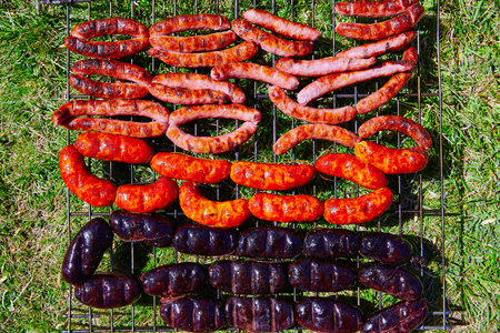 cue: Grilled sausages at bar b cue from Spain bar-b-cue