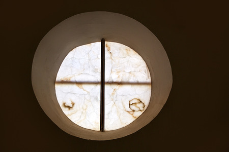 round window: alabaster round window with cross difussed light for churches in Spain