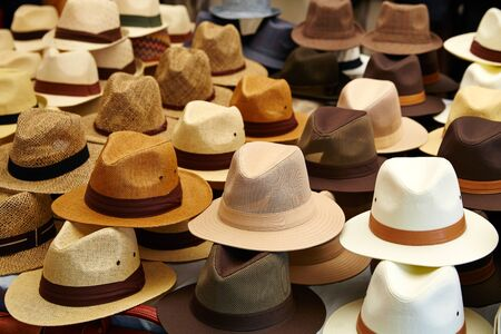 hat: Hats in outdoor store stacked in a row Stock Photo