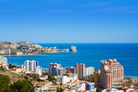 touristic: Cullera beach aerial with skyline of village in Mediterranean Valencia of Spain Stock Photo