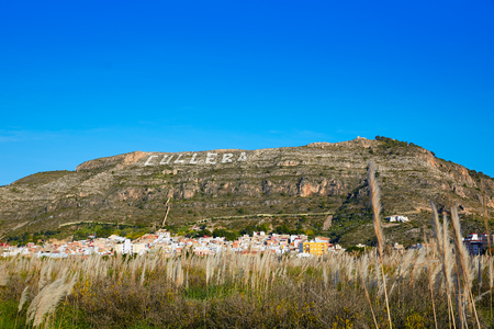 copyrighted: Cullera mountain with white sign writted on Valencia of Spain, sign non copyrighted