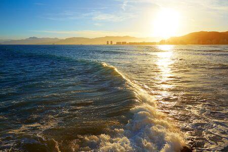 beach sunset: Cullera Playa los Olivos beach sunset in Mediterranean Valencia at Spain