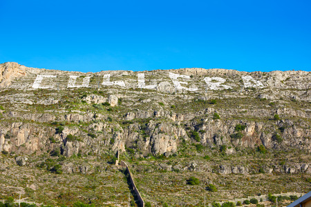 copyrighted: Cullera mountain with white sign writed on Valencia of Spain, sign non copyrighted