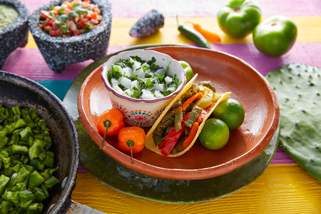 Nopal taco mexican food with chili pepper and ingredients on colorful table Stock Photo