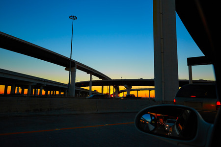 highway sign: Sunset in Highway with bridges in Houston Texas US