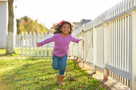 kid girl toddler playing running in park outdoor latin ethnicity Фото со стока - 56929103