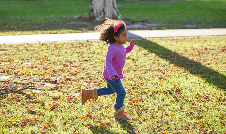 latin ethnicity: kid girl toddler playing running in park outdoor latin ethnicity