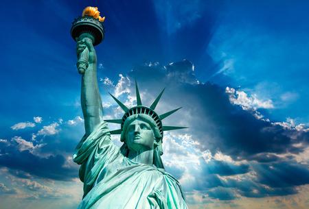 Liberty Statue New York American Symbol USA on dramatic sky