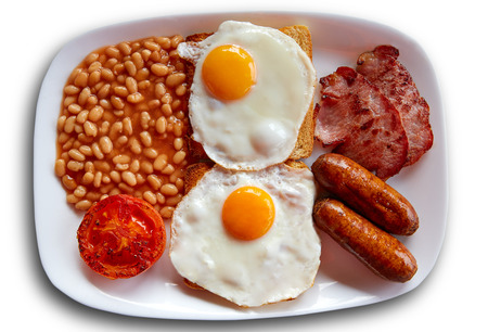 english breakfast: English breakfast with two eggs sausage beans bacon and grilled tomato