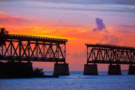 key of paradise: Florida Keys old bridge sunset at Bahia Honda Park in USA