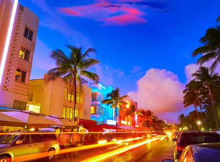 Miami Beach South Beach sunset in Ocean Drive Florida Art Deco and car lights Stock fotó