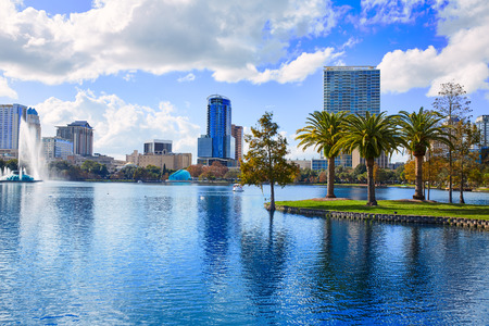 high view: Orlando skyline fom lake Eola in Florida USA with palm trees