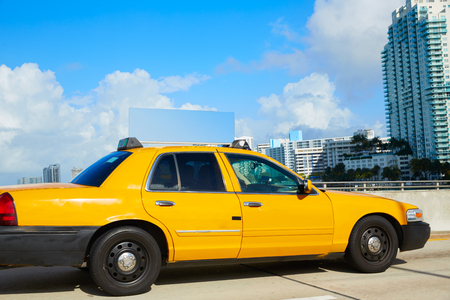 yellow cab: Miami beach yellow cab taxi in a bridge Florida USA
