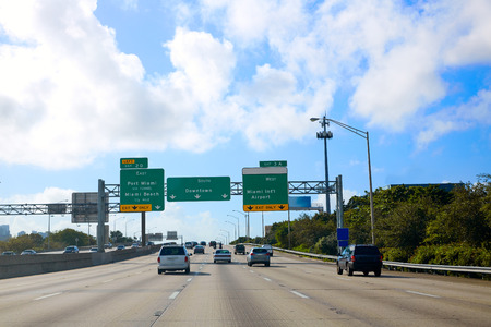 destinations: Miami Florida road sign to Downtown in USA