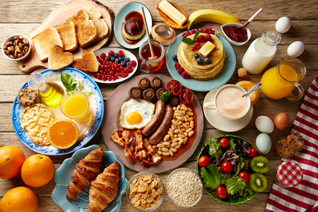 Breakfast buffet full continental and english coffee orange juice salad croissant fruit Banco de Imagens