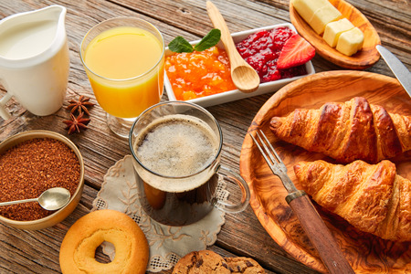 orange juice: Breakfast continental with croissant coffe and orange juice Stock Photo