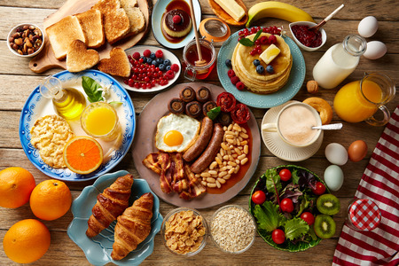 american cuisine: Breakfast buffet full continental and english coffee orange juice salad croissant fruit Stock Photo