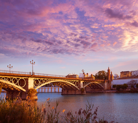 isabel: Puente Isabel II bridge sunset in Triana Seville of Andalusia Spain