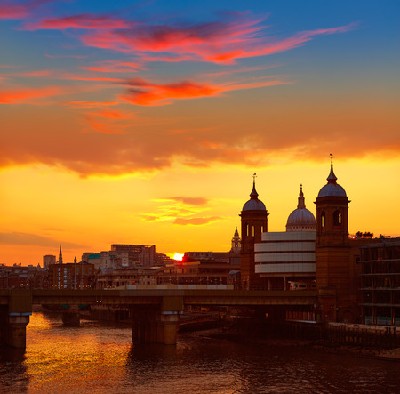 London Bridge sunset at Thames with St Paul Pauls Cathedral Stock Photo