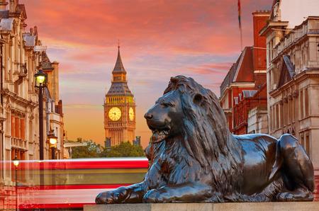 London Trafalgar Square lion and Big Ben tower at background Stok Fotoğraf