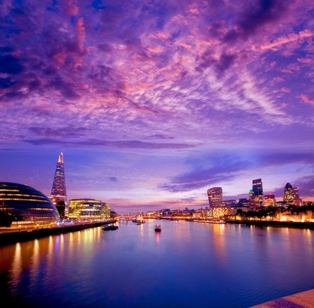London skyline sunset with City Hall and financial on Thames river Stock Photo