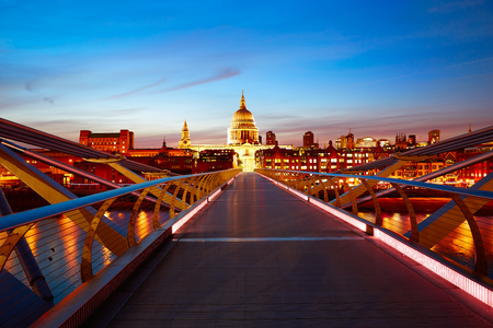 millennium bridge: London Millennium bridge sunset skyline in UK at dusk