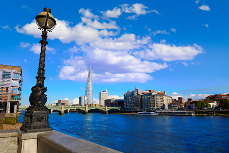shard: London Southwark bridge and the Shard on Thames river in UK Stock Photo