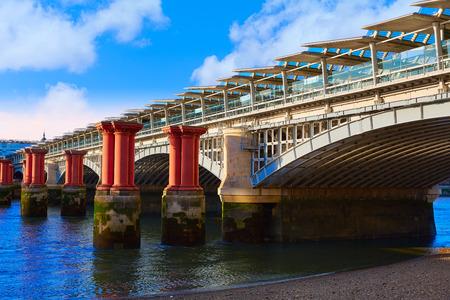 London Blackfriars Train bridge in Thames river UK
