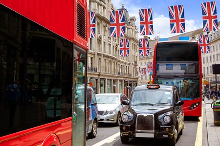 regent: London bus and Taxi Regent Street W1 Westminster in UK England Editorial