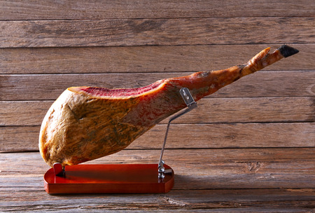 Iberian ham pata negra from Spain on wood background Banque d'images