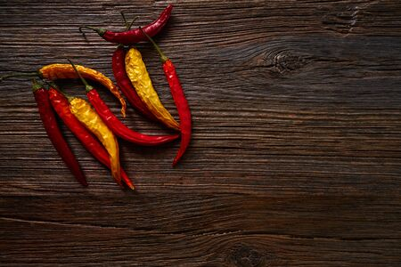aged wood: dried hot chili peppers on aged wood background