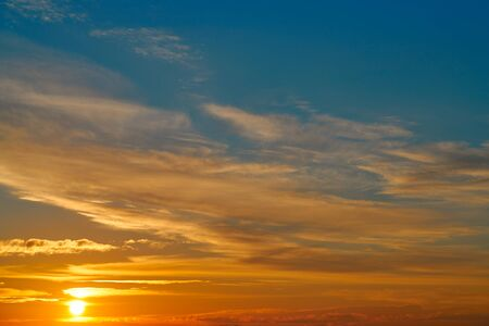sky background: Sunset sky orange clouds over blue background