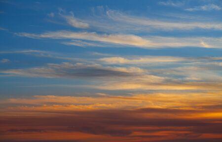 sunset sky: Sunset sky orange clouds over blue background