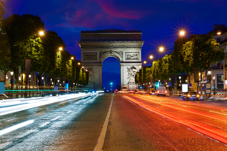 champs elysees: Arc de Triomphe in Paris Arch of Triumph sunset at France Stock Photo