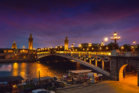 Pont Alexandre III in Paris France sunset over Seine river Stock Photo