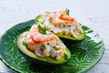 ajillo: Seafood filled avocado with shrimps tapas pinchos from Spain food recipes Stock Photo